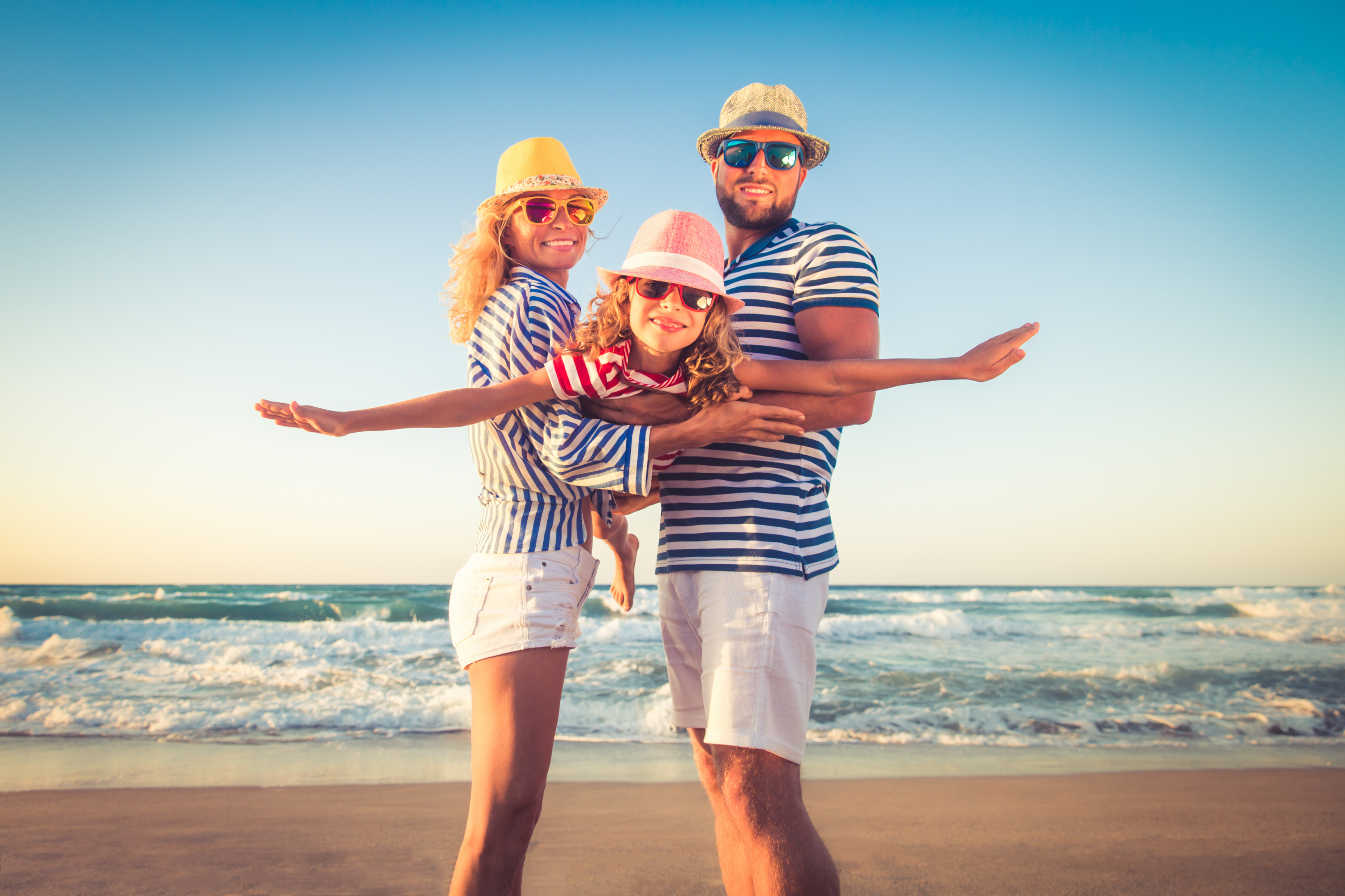 Happy family on the beach. People having fun on summer vacation_shutterstock_644382739.jpg